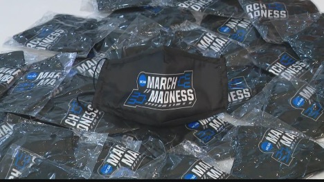 March Madness masks laying in a pile